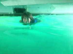 Madi enjoying the crystal clear water between our hulls.